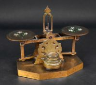 A set of Victorian engraved brass postal scales and weights, the pans enamelled with flowers,