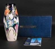 A Moorcroft vase, tube lined with flower