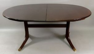 A G-Plan mahogany extending table, with