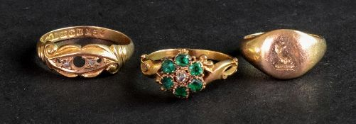 A Victorian yellow precious metal emerald and diamond set dress ring of cluster design,