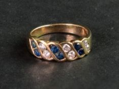 A gold sapphire and diamond set half hoo