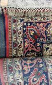 A modern Iranian carpet, with all-over floral designs and a central medallion, on a cream ground,
