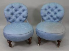 A pair of Victorian button down upholstered nursing chairs, with iron frames,
