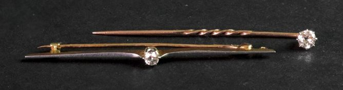 A diamond set stick pin, the brilliant c