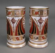 A pair of English porcelain cylindrical