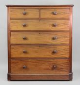 A tall Victorian mahogany chest, fitted with two short and four long drawers,