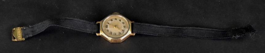 An 18ct gold cased octagonal wristwatch, the silvered dial with applied gilt metal Arabic numbers,