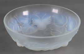 An Etling France 151 opalescent glass bowl, moulded with flowers and leaves, 20cm diameter.