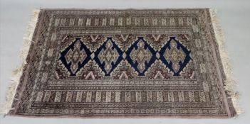 A Pakistan Bokhara rug, with four joined lozenges, 135 x 93cm,