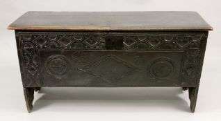 A 17th century oak coffer, with moulded