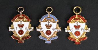 Three 9ct gold and coloured enamel Hants