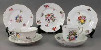 Two Herend porcelain cups, saucers and p