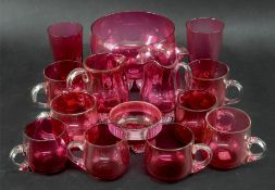 A collection of Victorian cranberry glassware including custard cups, bowl and jugs (qty).