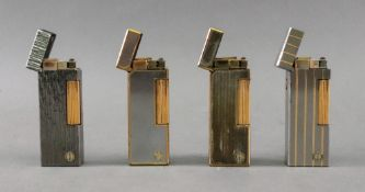 Four Alfred Dunhill lighters, including