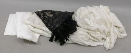 Two fine white bed covers, with crochet borders and inserts, late 19th/early 20th century,