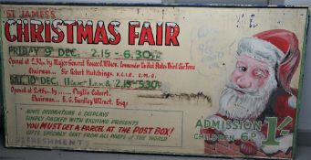 A large St James's Christmas fair wooden painted advertising board, mid 20th century, 248cm x 125cm.