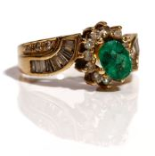 A gold, emerald and diamond ring, (the central oval cut emerald detached, but present),