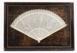 A Canton export ivory brise fan, late 18th century, the sticks carved with vases, flowerheads,