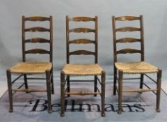 A set of five early 20th century stained beech ladderback dining chairs, 44cm wide x 99cm high,