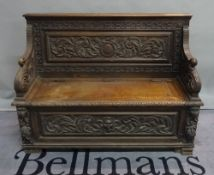 An 18th century style carved oak monk's bench, 122cm wide x 91cm high.