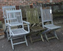 A matched set of six modern grey painted hardwood folding garden chairs to include two carvers,