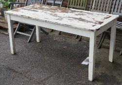 A modern white painted teak rectangular garden table, 150cm wide x 69cm high.