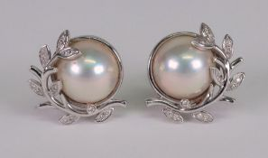 A pair of mabé pearl, 18ct white gold and diamond set earclips,