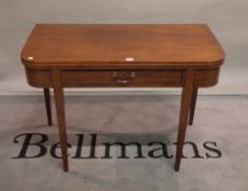 A Regency mahogany fold-over card table, with single freize drawer on tapering square supports,