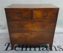 A 19th century mahogany chest of two short and two long drawers on bracket feet,