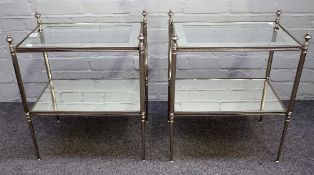 A pair of 20th century silvered metal and glass rectangular two tier occasional tables,