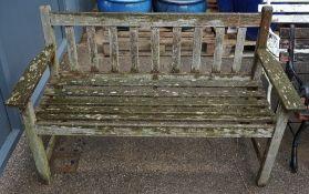 A teak slatted garden bench, 128cm wide x 81cm high.