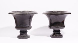 A pair of grey marble campana urns, 20th century, 32cm high.