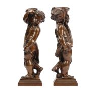 In the manner of Alfred Stevens (1817-1875), a pair of bronze fire dogs, modelled as putti,