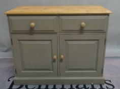 A pair of modern grey painted pine side cupboards on plinth bases, 116cm wide x 81cm high (2).