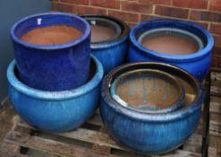 A group of eight modern garden pots, the largest, 50cm diameter x 30cm high (8).
