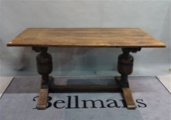 An 18th century style oak refectory dining table on bulbous turned supports, 153cm wide x 75cm high.