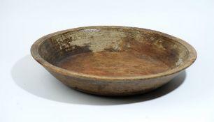 A large shallow turned hardwood fruit bowl, 59cm diameter x 11cm high.