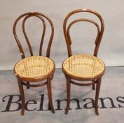 A pair of early 20th century Thonet style bentwood chairs, 92cm tall.