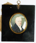 English School, early 19th Century, A portrait miniature of a gentleman wearing glasses,