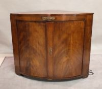 A large 19th century mahogany bowfront corner cabinet with gilt metal mounts,