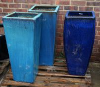 A group of three modern garden pots of tapering form, 39cm wide x 90cm high (3).