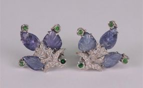 A pair of carved lavender jadeite,