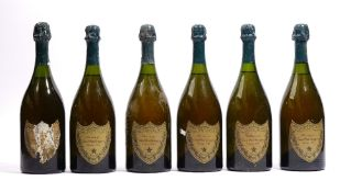 Six bottles of Dom Perignon vintage champagne, five 1966 and one having the label deteriorated.