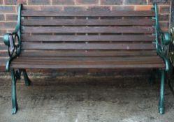 A modern cast aluminium and slatted hardwood garden bench, 128cm wide x 79cm high.