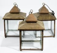 A set of three modern square copper glazed lanterns, 63cm high (3).