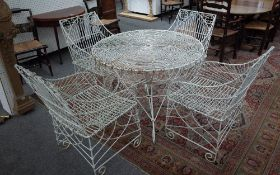 A suite of white painted wire work garden furniture to comprise circular table,