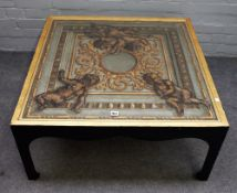 A 20th century square coffee table, polychrome painted with cherubs on a neo-classical background,