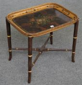 A Victorian papier-mâché tray, decorated with a floral reserve against a faux burr wood ground,