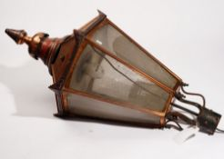 A copper lantern, of hexagonal tapering form, with frosted perspex and pear shaped spire,