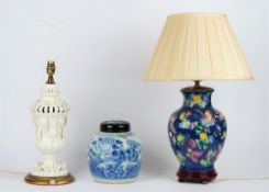 A white glazed pottery table lamp on a circular gilt painted base, 44cm high,